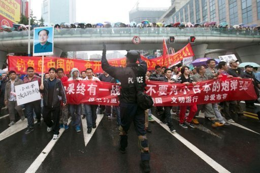 &lt;p&gt;A Chinese riot policeman directs protesters in Chengdu, Sichuan province. Thousands of anti-Japanese demonstrators have mounted protests in cities across China over disputed islands in the East China Sea, a day after an attempt to storm Tokyo&#39;s embassy in the capital.&lt;/p&gt;