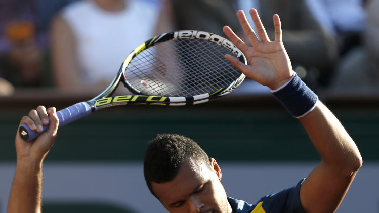 France's Jo-Wilfried Tsonga reacts as he plays Spain's David Ferrer during their semifinal match of the French Open tennis tournament at the Roland Garros stadium Friday, June 7, 2013 in Paris. (AP Photo/Petr David Josek)