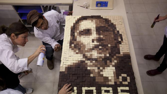 Students of Estella's school for bakery and pastry making, work on an image depicting U.S. President Barack Obama made out of chocolate in Givat Shmuel, central Israel, Monday, March 18, 2013. Obama's trip to Jerusalem and the West Bank will take place March 20-22, and it is the U.S. leader's first trip to the region as president, and his first overseas trip since being reelected. (AP Photo/Ariel Schalit)