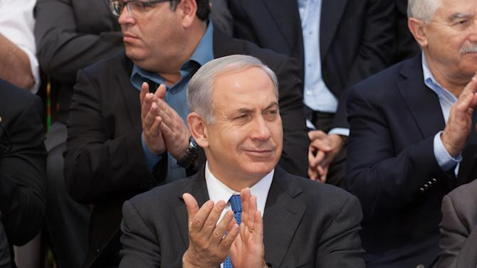 Israeli Prime Minister Benjamin Netanyahu applauds as he attends the weekly cabinet meeting at the Herzl Museum, in Jerusalem, Israel, Sunday, May 5, 2013. Israeli warplanes struck areas in and around the Syrian capital Sunday, setting off a series of explosions as they targeted a shipment of highly accurate, Iranian-made guided missiles believed to be on their way to Lebanon's Hezbollah militant group, officials and activists said. (AP Photo/Emil Salman, Pool)
