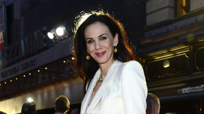 """FILE - This Oct. 18, 2012 file photo shows L'Wren Scott at the London Film Festival American Express Gala for """"The Rolling Stones - Crossfire Hurricane"""", in London. Scott, a fashion designer, was found dead, Monday, March 17, 2014, in Manhattan. Her funeral was held Tuesday, March 25, at Hollywood Forever Funeral Home in Los Angeles. (Photo by Jon Furniss/Invision, File)"""