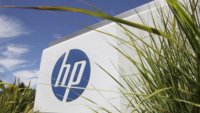 This Tuesday, Aug. 21, 2012, photo, shows an exterior view of Hewlett Packard Co. headquarters in Palo Alto, Calif. On Wednesday, Aug. 22, 2012, Hewlett-Packard Co. said it suffered an $8.9 billion loss during its most recent quarter after taking a previously announced charge against earnings for an acquisition that hasn't panned out the way management envisioned. The maker of personal computers is struggling to compete with mobile devices. (AP Photo/Paul Sakuma)