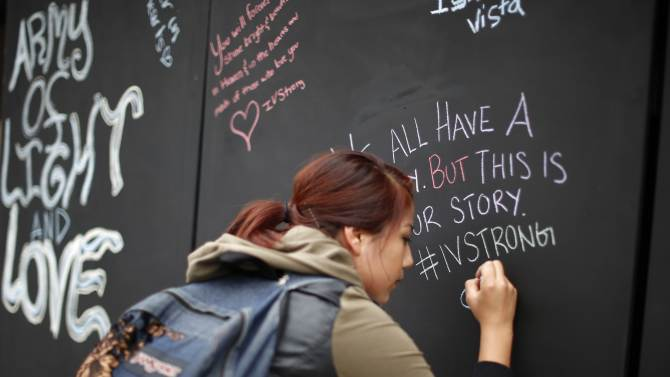 Student signs on a remembrance wall in the Isla Vista neighborhood of Santa Barbara