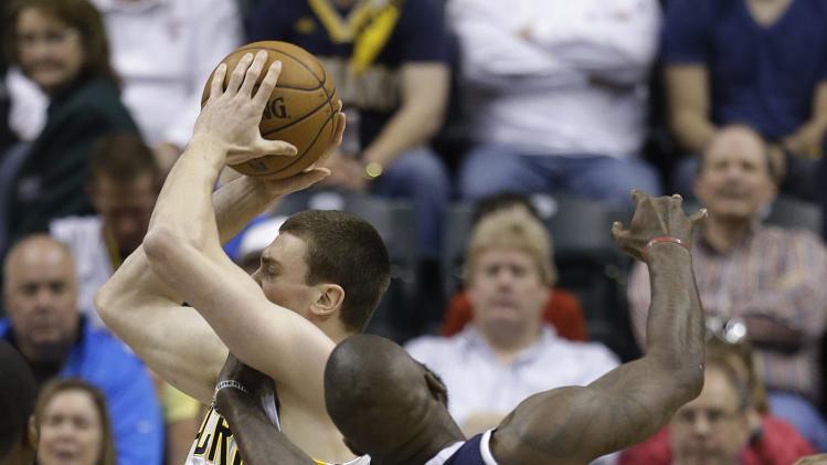 Indiana Pacers' Tyler Hansbrough, left, goes to the basket against Atlanta Hawks' Ivan Johnson during the first half of Game 1 in the first round of the NBA basketball playoffs on Sunday, April 21, 2013, in Indianapolis. (AP Photo/Darron Cummings)