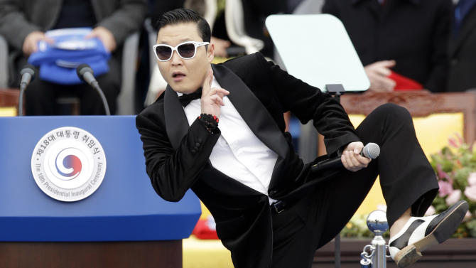 """FILE - In this Feb. 25, 2013 file photo, South Korean rapper PSY performs before President Park Geun-hye's presidential inauguration ceremony at the National Assembly in Seoul, South Korea. Sporting a black suit and a sleek haircut, a 7-year-old boy, Hwang Min-woo performed at a news conference in South Korea on Wednesday, March 6, 2013. The impish boy nicknamed """"Little PSY"""" is releasing an electro pop song next week through iTunes. Min-woo says he wants to gain global fame like his """"big brother,"""" PSY. (AP Photo/Lee Jin-man, FIle)"""