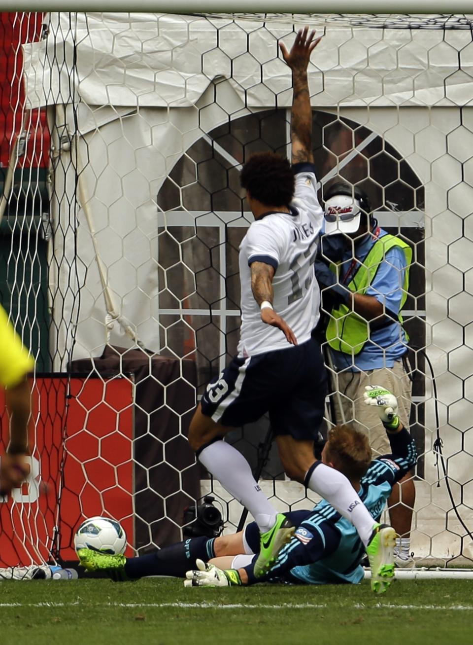 U.S. midfielder Jermaine Jones (13) celebrates as his shot goes past Germany goalkeeper Marc-Andreter Stegen (22) during the first half of an international friendly soccer match at RFK Stadium Sunday, June 2, 2013, in Washington. (AP Photo/Alex Brandon)