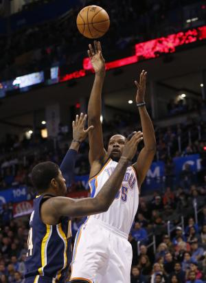 Oklahoma City Thunder forward Kevin Durant (35) shoots over Indiana Pacers forward Paul George (24) in the first quarter of an NBA basketball game in Oklahoma City, Sunday, Dec. 8, 2013. (AP Photo/Sue Ogrocki)