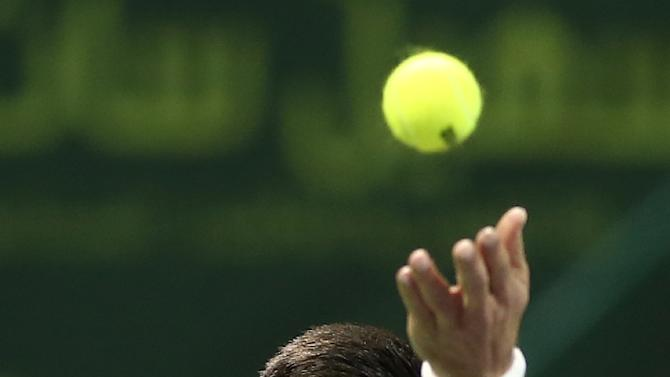 Novak Djokovic of Serbia serves the ball to Argentina's Leonardo Mayer ...
