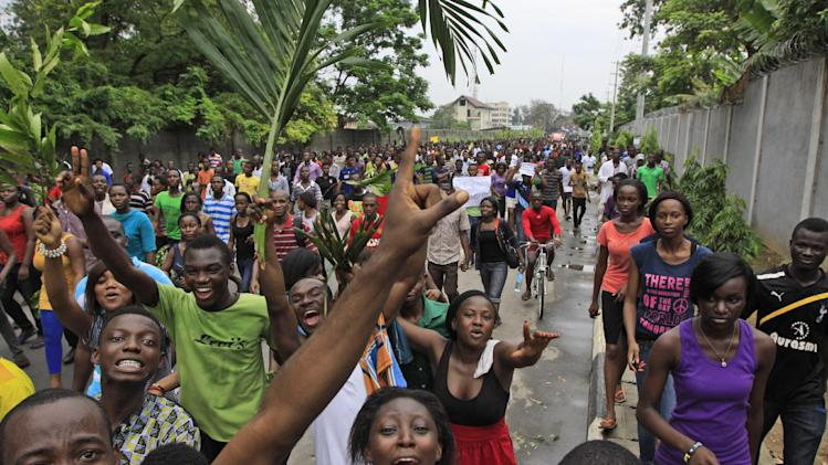 """Students of university of Lagos protest following the renaming of the University by Nigerian President Goodluck Jonathan in Lagos, Nigeria, Tuesday, May 29. 2012. Nigeria has renamed a major university in the commercial capital of Lagos after a political prisoner who died in jail over a decade ago. President Goodluck Jonathan announced Tuesday on state-run television that the University of Lagos would be renamed Moshood Abiola University in honor of the presidential hopeful's """"martyrdom.""""  (AP Photo/Sunday Alamba)"""