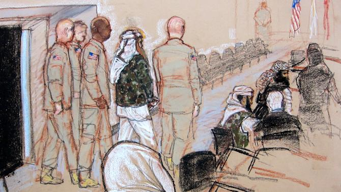 In this pool photo of a sketch by courtroom artist Janet Hamlin and reviewed by the U.S. Department of Defense, the self-proclaimed terrorist mastermind Khalid Sheikh Mohammed, fourth from left, is brought inside the courtroom escorted by four military officers to attend the hearing of the death penalty case against the five Sept. 11 defendants at the Guantanamo Bay U.S. Naval Base in Cuba, Monday, Feb. 11, 2013. (AP Photo/Janet Hamlin, Pool)