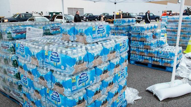 The GeStamp Stamping Plant-South Charleston (W.Va.) is one of several distribution locations open Sunday morning, Jan. 12, 2014 so local residents can pick up bottled water and fill containers after a chemical spill Thursday in the Elk River that has contaminated the public water supply in nine counties. Frustration is mounting for many of the 300,000 West Virginia residents who've gone three days without clean tap water..This location will remain open 24-hours a day until the ban on using tap water for drinking and washing is lifted. (AP Photo Michael Switzer)