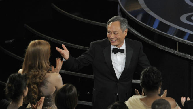 """Ang Lee walks on stage to accept the award for best directing for """"Life of Pi"""" during the Oscars at the Dolby Theatre on Sunday Feb. 24, 2013, in Los Angeles.  (Photo by Chris Pizzello/Invision/AP)"""
