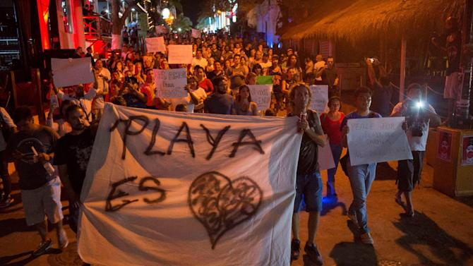 People march in memory of those who were killed or injured after a gunman opened fire at the Blue Parrot nightclub during a BPM electronic music festival held at the venue, in Playa del Carmen