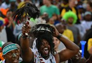 Nigeria football fans cheer their team prior to the 2013 Africa Cup of Nations final between Nigeria vs Burkina Faso in Soweto, Johannesburg, on February 10, 2013