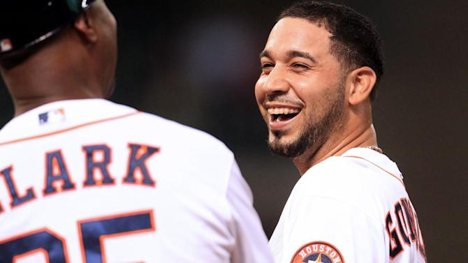 Houston Astros shortstop Marwin Gonzalez (9) reacts on first base after breaking up a perfect game with two outs in the bottom of the 9th inning by Ranger's Yu Darvish Tuesday, April 2, 2013, in Houston. (AP Photo/Karen Warren, Houston Chronicle)