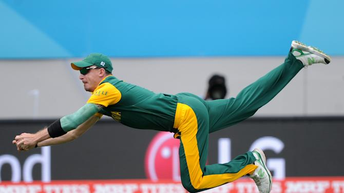 South Africa's Dale Steyn is airborne as he dives to take a catch to dismiss Pakistan batsman Ahmad Shahzad during their Cricket World Cup Pool B match in Auckland, New Zealand, Saturday, March 7, 2015. (AP Photo/Ross Setford)