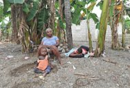 Haitians sit amid their destroyed home and banana grove on November 17 in the Nippes section of Haiti. Hurricane Sandy, the deadly storm that slammed into New York and New Jersey in October, tore through the Caribbean long before reaching America -- and in Haiti, many still await help