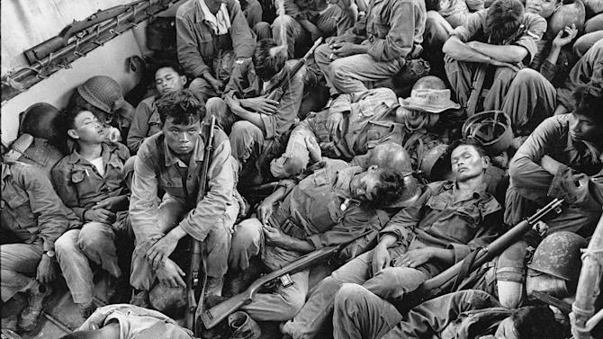 FILE - In this Aug. 1962 file photo shot by Associated Press photographer Horst Faas, South Vietnamese government troops from the 2nd Battalion of the 36th Infantry sleep in a U.S. Navy troop carrier on their way back to the Provincial capital of Ca Mau, Vietnam. Faas, a prize-winning combat photographer who carved out new standards for covering war with a camera and became one of the world's legendary photojournalists in nearly half a century with The Associated Press, Thursday May 10, 2012. He was 79. (AP Photo/Horst Faas, File)