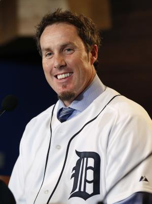 Detroit Tigers pitcher Joe Nathan smiles after being introduced at a news conference in Detroit Wednesday, Dec. 4, 2013. The Detroit Tigers agreed to terms with free agent reliever Joe Nathan on a two-year contract with a club option for 2016 on Wednesday. (AP Photo/Paul Sancya)