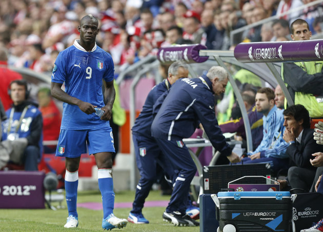 FILE - The June 14, 2012 file photo shows Italy&#39;s Mario Balotelli leaving the pitch after being substituted during the Euro 2012 soccer championship Group C match between Italy and Croatia in Poznan, Poland. UEFA has charged the Croatian football federation with its fans&#39; bad behavior. (AP Photo/Jon Super)