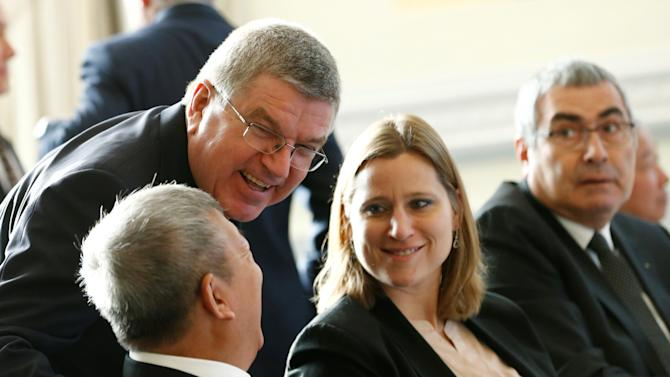 IOC President Bach speaks with IOC members Ng, Ruggiero and Erdener before an Executive Board meeting in Lausanne