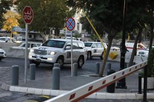 U.N. vehicles transporting a team of experts from the Organization for the Prohibition of Chemical Weapons (OPCW) return to their hotel in Damascus