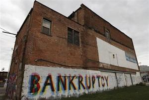 "File photo of the word ""Bankruptcy"" is painted on the side of a building in Detroit Michigan"