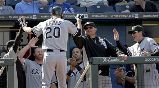 Danks homers in 11th, White Sox beat Royals