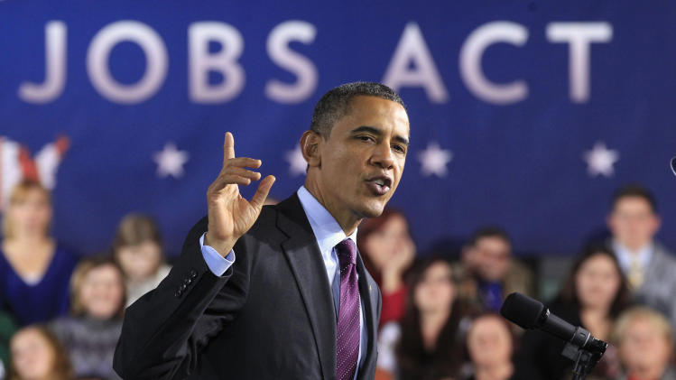 U.S. President Obama delivers remarks on the American Jobs Act at Manchester High School Central in Manchester