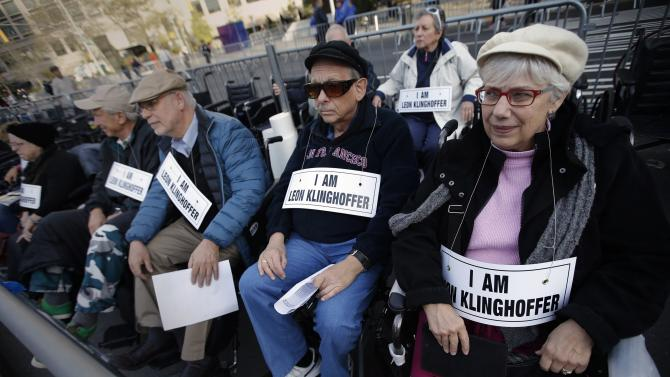 Protesters sit in wheelchairs during a demonstration across from Lincoln Center and the New York Metropolitan Opera during in New York