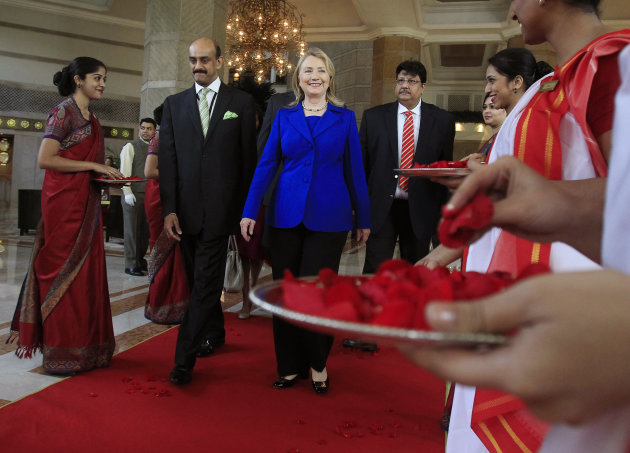 U.S. Secretary of State Hillary Rodham Clinton leaves the Taj Hotel in Kolkata Monday, May 7, 2012. Clinton urged energy-starved India on Monday to reduce its Iranian oil imports to keep up pressure o