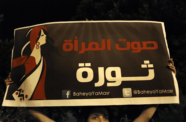 "An Egyptian female activist carries a placard that reads in Arabic ""the woman's voice is a revolution,"" during an anti Islamist dominated constitutional assembly protest in Cairo, Egypt, Tuesday, Oct. 2, 2012. Islamists are seeking to enshrine in Egypt's new constitution a number of articles that secularists and liberals fear would bring theocratic rule and severely set back civil liberties, including provisions empowering clerics to review laws and restricting women's rights. (AP Photo/Nasser Nasser)"
