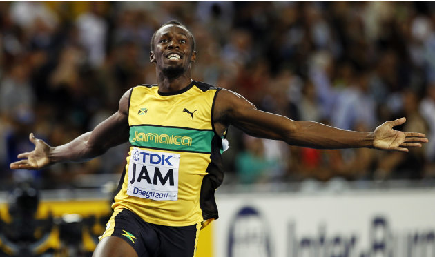 FILE - This Sept. 4, 2011 file photo shows Jamaica's Usain Bolt celebrating after winning the men's 4x100 relay final,  and setting a world record,  at the World Athletics Championships in Dae