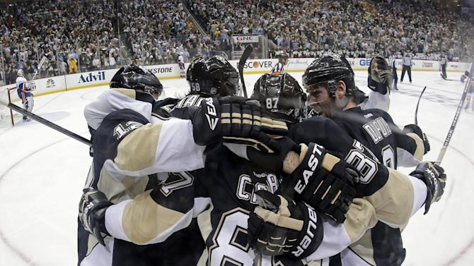 Pittsburgh Penguins' Sidney Crosby (87) celebrates with teammates after scoring during the second period of Game 5 of an NHL hockey Stanley Cup first-round playoff series, against the New York Islanders, Thursday, May 9, 2013, in Pittsburgh. The Penguins won 4-0, to lead the series 3-2. (AP Photo/Gene J. Puskar)