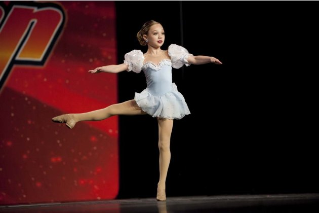"Maddie twirls on stage in ""Dance Moms."""