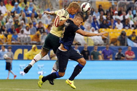 Milan forward Keisuke Honda, left, of Japan, and Manchester City defender Matija Nastasic go up for a header during the first half of a soccer match in the first round of the Guinness International Champions Cup at Heinz Field on Sunday, July 27, 2014, in Pittsburgh