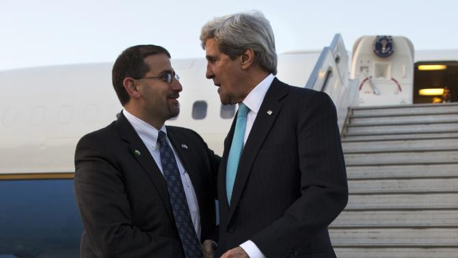 U.S. Ambassador to Israel Shapiro greets U.S. Secretary of State Kerry after Kerry landed at Ben Gurion airport near Tel Aviv