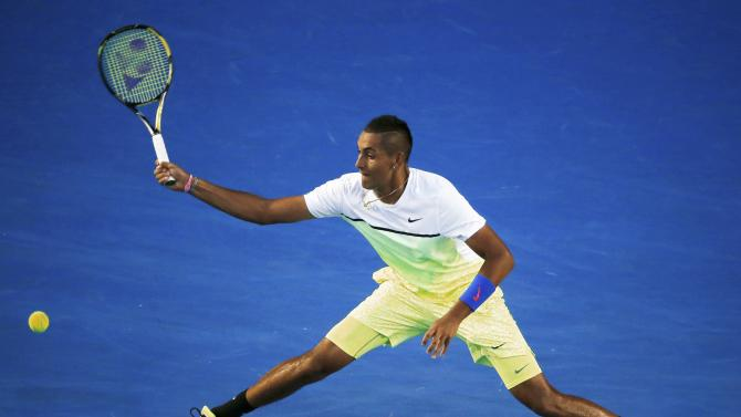 Nick Kyrgios of Australia stretches to hit a return against Andy Murray of Britain during their men's singles quarter-final match at the Australian Open 2015 tennis tournament in Melbourne