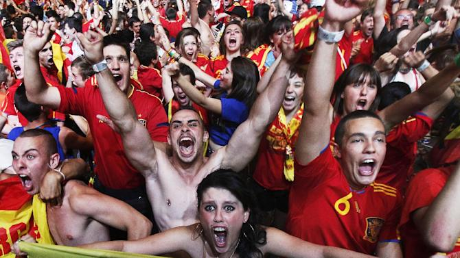 Spanish soccer fans celebrate their victory in the Euro 2012 soccer championship semifinal match between Spain and Portugal at the Fan Zone in Madrid, Spain, Wednesday, June 27, 2012. Spain beat Portugal 4-2 in a penalty shootout on Wednesday to reach the final of Euro 2012. (AP Photo/Andres Kudacki)
