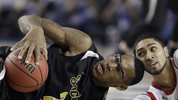 Wichita State's Carl Hall (22) and Louisville's Russ Smith vie for the loose ball during the second half of the NCAA Final Four tournament college basketball semifinal game, Saturday, April 6, 2013, in Atlanta. (AP Photo/Charlie Neibergall)