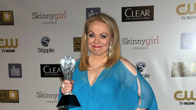 """Jacki Weaver poses backstage with the award for best comedy movie for """"Silver Linings Playbook"""" at the 18th Annual Critics' Choice Movie Awards at the Barker Hangar on Thursday, Jan. 10, 2013, in Santa Monica, Calif. (Photo by John Shearer/Invision/AP)"""