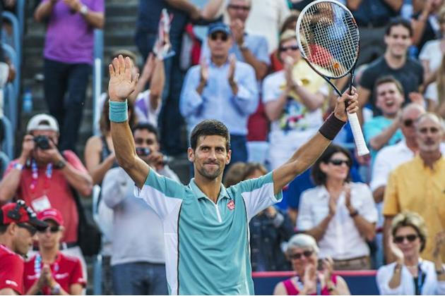 Novak Djokovic celebrates after defeating Richard Gasquet at the Rogers Cup in Montreal on August 9, 2013