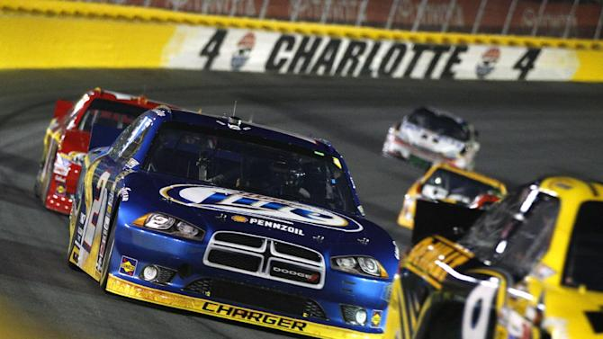 Brad Keselowski (2) races out of Turn 4 during the NASCAR Bank of America 500 Sprint Cup series auto race in Concord, N.C., Saturday, Oct. 13, 2012. (AP Photo/Chuck Burton)