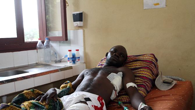 A man wounded in sectarian clashes rests on a bed at the General hospital of Bangui on September 30, 2015