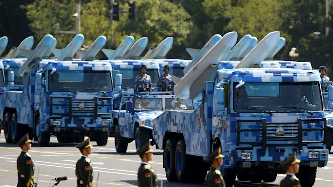 Marine corps vehicles carrying ship-to-air missiles drive past the Tiananmen Square during the military parade marking the 70th anniversary of the end of World War Two, in Beijing