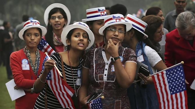 Indian students react to results on television networks during an event organized by the U.S. embassy at the landmark Imperial Hotel in New Delhi, India, Wednesday, Nov. 7, 2012. Obama captured a second White House term, blunting a mighty challenge by Republican Mitt Romney as Americans voted for a leader they knew over a wealthy businessman they did not. (AP Photo/Kevin Frayer)