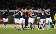 Luton Town players celebrate defeating Norwich City 0-1 in their English FA Cup fourth round soccer match at Carrow Road, Norwich, England,Saturday Jan. 26, 2013. See PA Story SOCCER Norwich. (AP Photo/PA, Chris Radburn)