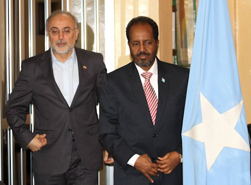 Somalia's President Hassan Sheikh Mohamud and Iranian Foreign Minister Ali Akbar Salehi pose for photographs before addressing a joint news conference in Mogadishu