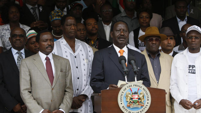 Kenyan Prime Minister Raila Odinga, third from right, addresses the media outside his office before moving to file a case with the Supreme Court over what he says is massive fraud that took place during the country's March 4 election, in Nairobi, Kenya, Saturday, March 16, 2013. Uhuru Kenyatta won the election with 50.07 percent of the vote. Saturday is the last day Odinga can file a petition to protest the result. Kenya's election has been largely peaceful, unlike the 2007 vote that sparked two months of violence that killed more than 1,000 people. (AP Photo/Sayyid Azim)