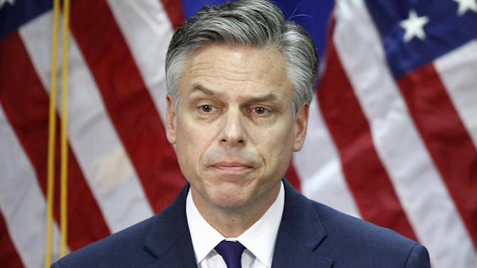 "FILE - In this  Monday, Jan. 16, 2012, file photo, Republican presidential candidate, former Utah Gov. Jon Huntsman, pauses while announcing he is ending his campaign in Myrtle Beach, S.C. Huntsman is joining about a dozen members of Congress on Monday to band together under the ""No Labels"" alliance that aims to put governing over political orthodoxy. (AP Photo/Charles Dharapak, File)"
